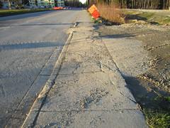 Damaged sidewalk on 25th Avenue NE