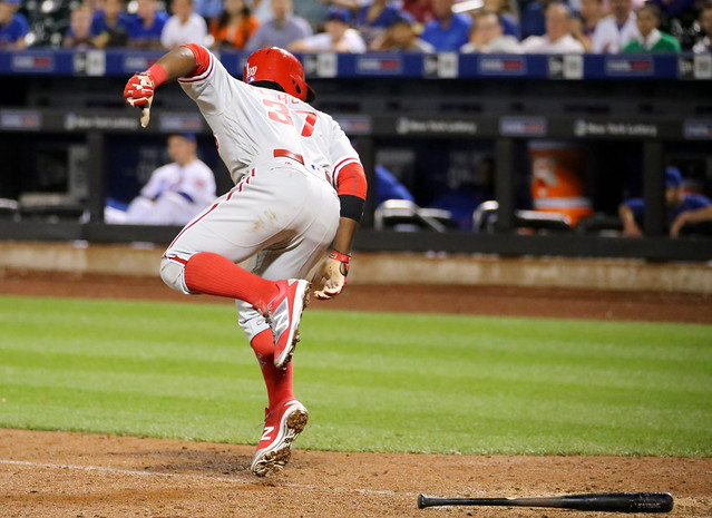 The Phillies' Odubel Herrera is hit by a pitch in the 11th inning.