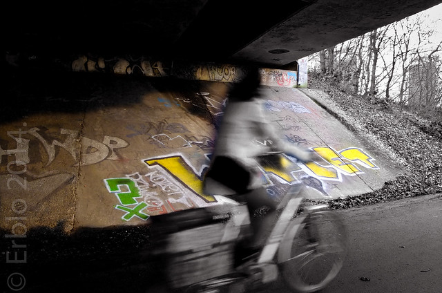 bike passing under bridge, PS, Fujifilm X10, Streetphotography.