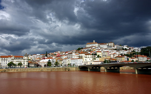 city trip travel bridge light red sky colour portugal water rain architecture clouds contrast river landscape photography europe university rooftops riverside camino hill sightseeing dramatic visit midday coimbra mondego riomondego pentaxk5ii pietkagab
