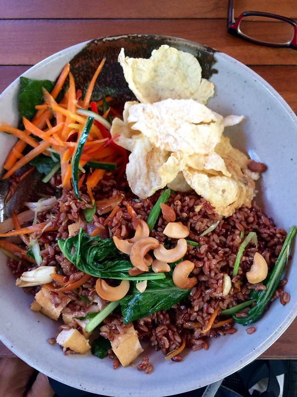 Nasi goreng with brown rice, nuts, greens, carrots, crackers, etc