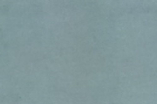 sample_zoom_1_cropped_resized カメラの望遠端で撮影した室内のカーテンの生地の写真。
