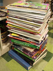 tall stack of books and magazines