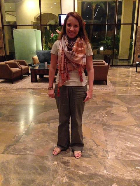 Rachelle in Jordan wearing a t-shirt, linen pants, and a scarf.
