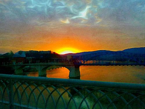 blue sunset sky orange white reflection green water yellow clouds golden evening twilight glow dusk tennessee horizon gray rays walnutstreetbridge goldensunset tennesseeriver chattanoogatn tennesseeaquarium marketstreetbridge