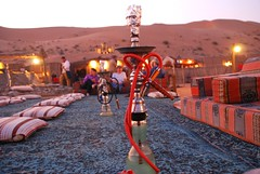 Shisha Pipe amidst the traditional seating at a Desert Safari Camp in Dubai.
