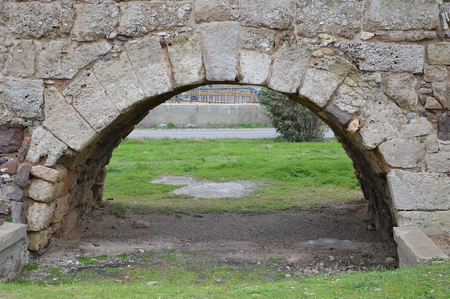 Roman bridge, one of the barrel-vaulted arches about 5.0 m large made of square blocks of sandstone,  restructured and restored in medieval times, Sant'Antioco, Sardinia