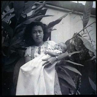 Anna van Waeterschoodt holding her youngest sister on her Christeningday? in Batavia in the Dutch East Indies 1940