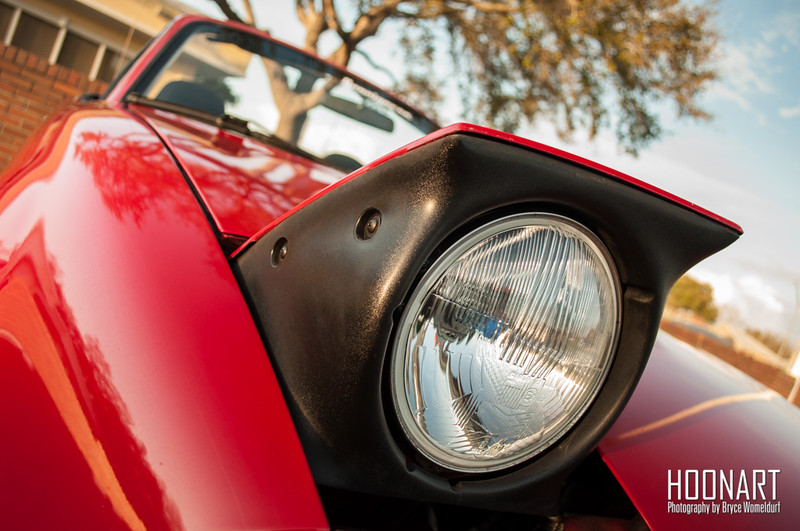 Artsy photo of Roadster's pop up headlight.