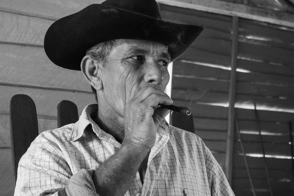 Tobacco Farmer smokes a cigar in his house in Vinales, Cuba.jpg