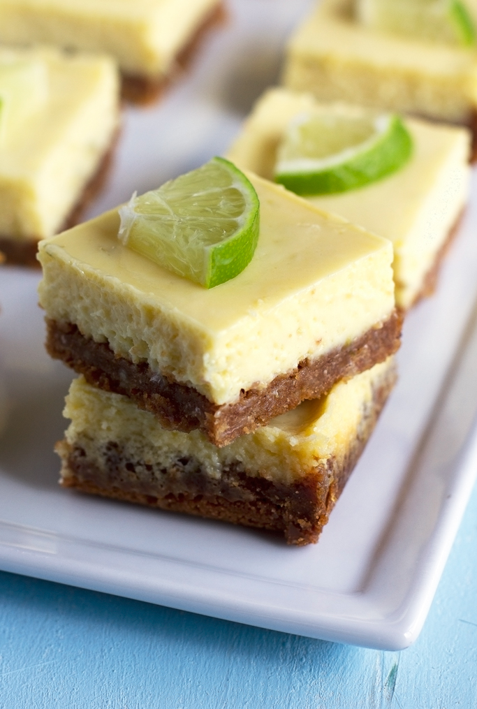 squares of key lime pie stacked on white plate