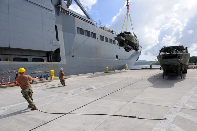Sailors offload riverine command boats.