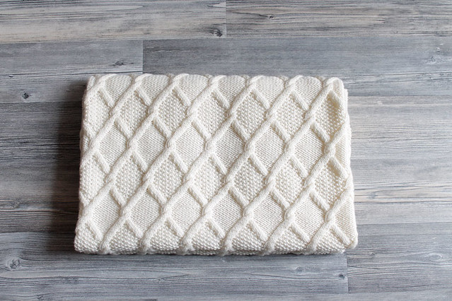 White cabled baby blanket