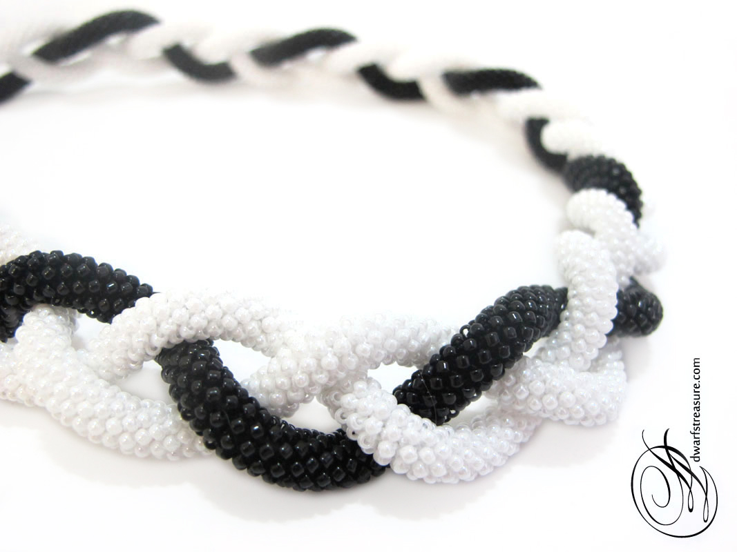 classic color combination of black and white long beaded necklaces