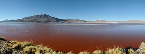 Volcano at the shore of the red lagoon, Bolivia Highlands
