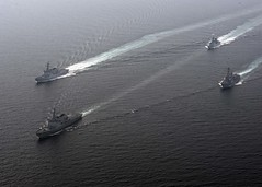 ROKS Seoae Ryusungryong (DDG 993), front, and clockwise, ROKS Yul Gok Yii (DDG 992), ROKS Kang Gam Chan (DDH 979) and USS Spruance (DDG 111) maneuver together during a combined maritime operation, Sept. 26. (U.S. Navy/MC2 William Gaskill)