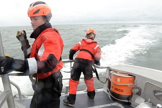 Petty Officer 3rd Class Joseph Hicks and Petty Officer 3rd Class Leeann Palazzolo, crewmembers at Coast Guard Station Manasquan Inlet, N.J., participate in a man-overboard drill offshore from Manasquan Thursday, Oct. 23, 2014. The station's crew regularly train for their primary missions, which include search and rescue, law enforcement and recreational boating safety. (U.S. Coast Guard photo by Petty Officer 2nd Class Cynthia Oldham)