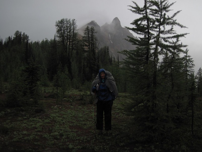 Vicki in raingear with Mount Hardy in the clouds as we prepare to hike north from Methow Pass