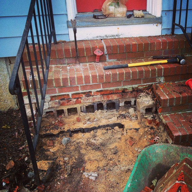 I've hated our front stairs from the first day we looked at the house. Today they came to their end.