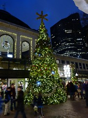 Christmas tree with Black Friday shoppers