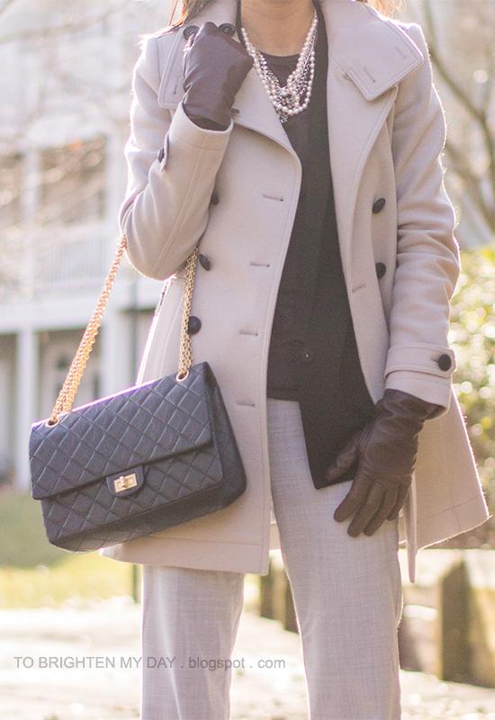 gray wool trench coat, black vest, purple tee, mixed metal necklace, purple gloves, gray pants