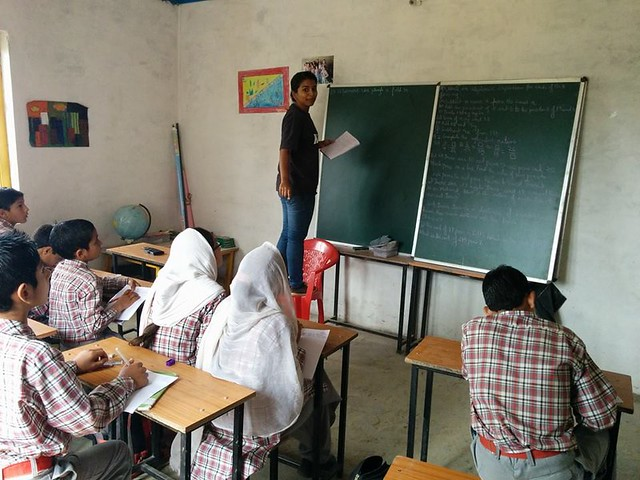 A teacher having her lecture in classroom of HPS