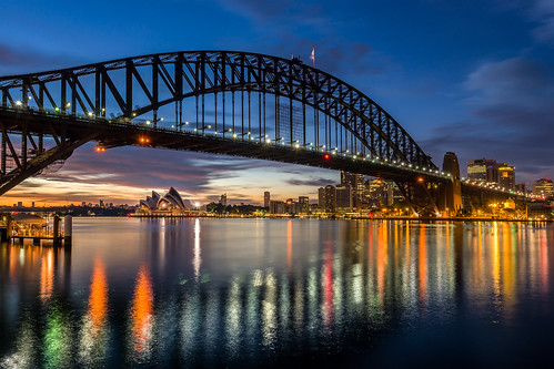 city travel reflection water skyline sunrise dawn cityscape harbour sydney australia nsw newsouthwales operahouse australiaday sydneyoperahouse sydneyharbourbridge
