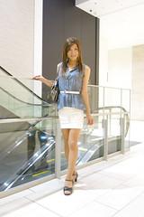 Blue sleeveless shirt and White tight miniskirt_7