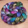 """My next spin,  a 60/40 Polwarth blend by @pigeonroofstudios I am so freaking excited!  This is my first braid from this amazing dyer.  Colorway is ooak entitled """"Brilliance"""""""