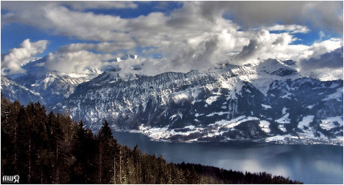 travel blue winter sky panorama lake snow mountains alps weather clouds forest canon landscape schweiz switzerland europe view lonelyplanet snowscape winterscape berneseoberland winterbeauty lakethun cantonberne thebeautyofnature