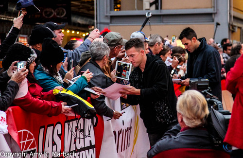 AJ Allmendinger and Aric Armirola sign autographs for fans along the red carpet