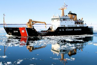 The crew of the Coast Guard Guard Cutter Hollyhock, homeported in Port Huron, Mich., transits Lake St. Clair en route to the western basin of Lake Erie for ice-breaking operations, Jan. 13, 2015. U.S. and Canadian Coast Guard ice breakers, as part of Operations Coal Shovel and Taconite, have been working tirelessly to keep vessel traffic and important economic supplies moving throughout the Great Lakes. (U.S. Coast Guard photo by Chief Petty Officer Nick Gould)