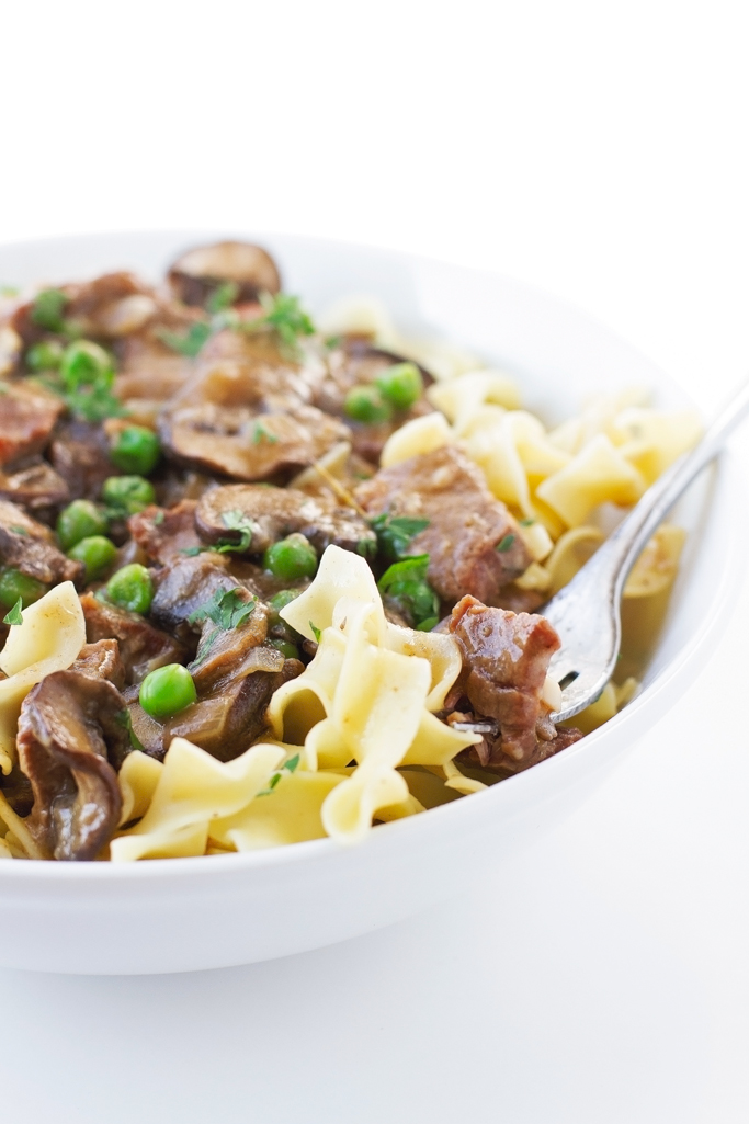 Beef Stew with Mushrooms over Egg Noodles - An easy to make stew with just a 20 minute prepwork! #stew #pasta #beefstew #dutchoven | Littlespicejar.com