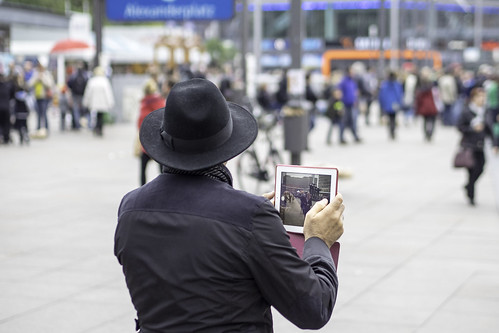 Man with iPad, photographing
