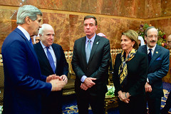 U.S. Secretary of State John Kerry, U.S. Senator John McCain of Arizona, U.S. Senator Mark Warner of Virginia, House Minority Leader Nancy Pelosi of California, and U.S. Representative Eliot Engel of New York chat before greeting the new King Salman of Saudi Arabia at the Erqa Royal Palace in Riyadh, Saudi Arabia, on January 27, 2015, after extending condolences to the late King Abdullah. [State Department photo/ Public Domain]