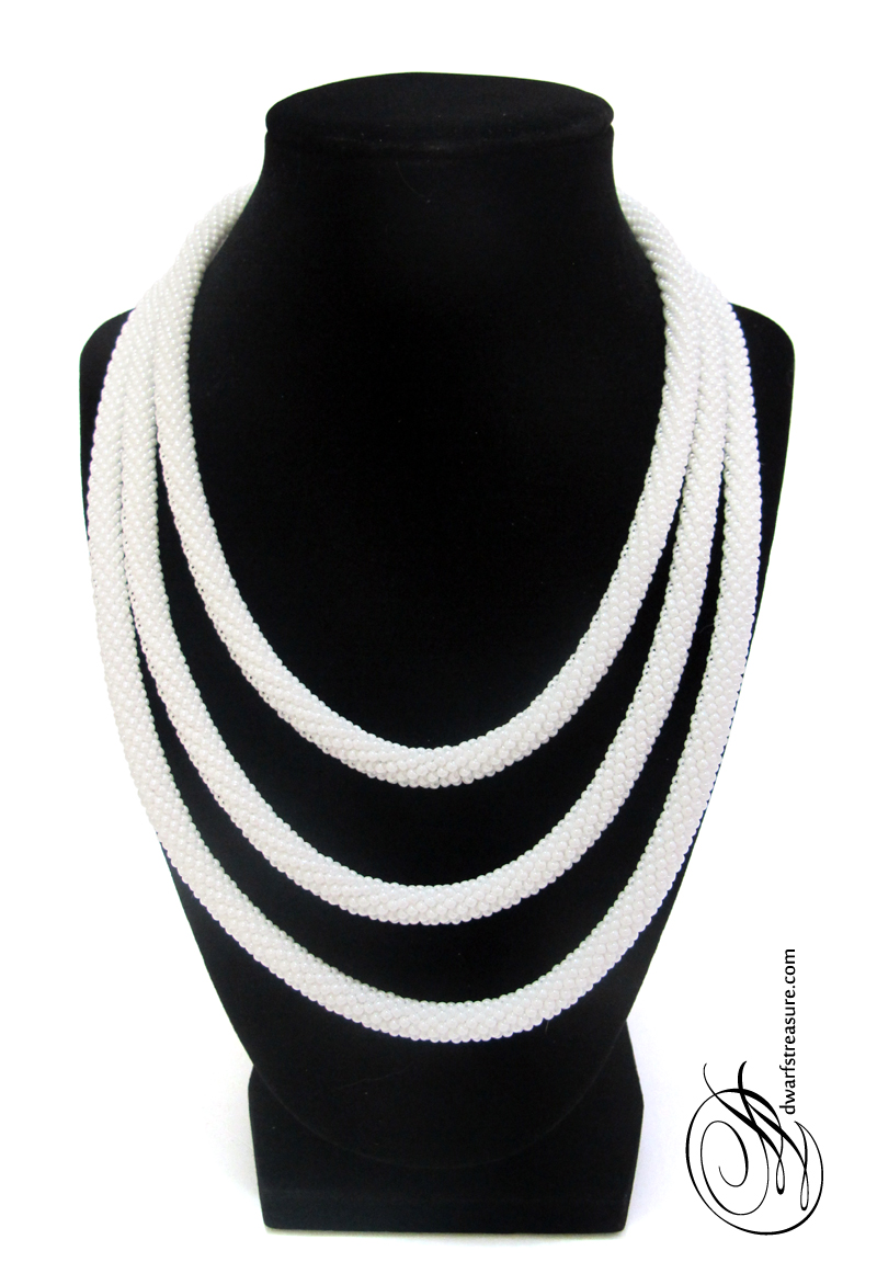 White beaded long necklace wrapped around