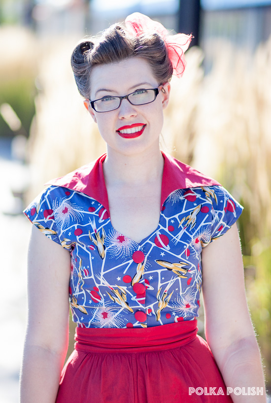 Sci-Fi Rockets print bolero from Trashy Diva features atomic-styled spaceships and planets in red, blue, white, and gold.