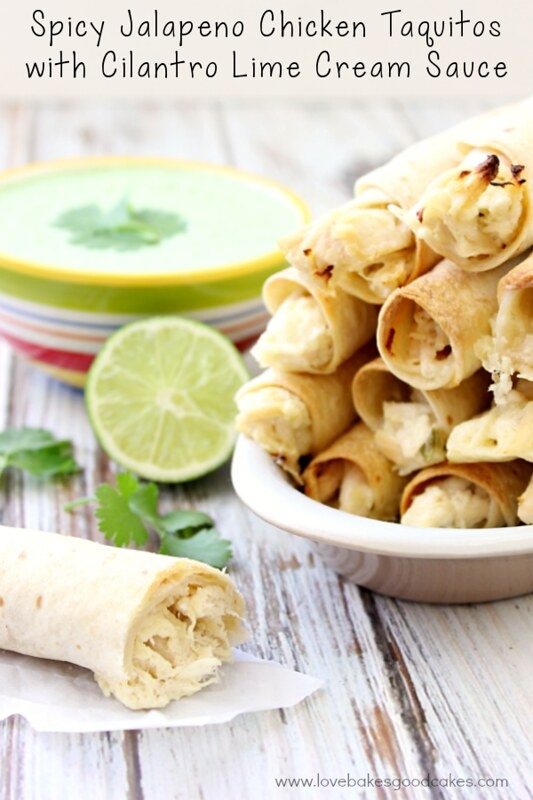 Spicy Jalapeno Chicken Taquitos stacked up in a white dish with Cilantro Lime Cream Sauce and a lime.