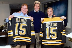 Canadian Foreign Minister John Baird, left, and Mexican Foreign Secretary José Antonio Meade, right, display Boston Bruins jerseys given to them by U.S. Secretary of State John Kerry in TD Garden in Boston, Massachusetts, as they watched the Bruins-Los Angeles Kings game following a North American Ministerial meeting involving the three in the Secretary's hometown on January 31, 2015. [State Department photo/ Public Domain]