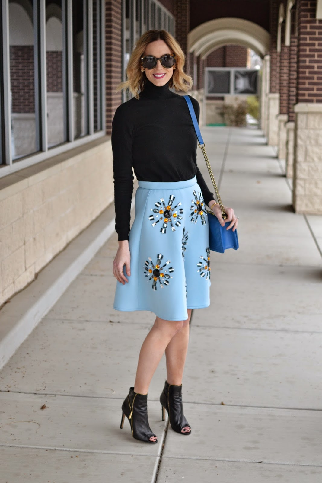 Sheinside baby blue midi skirt, black turtleneck, black booties, karen walker super duper, Honeybee jewelry