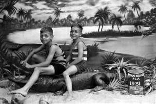 Stanley and Milton Weinkle sitting on a stuffed alligator - Miami Beach