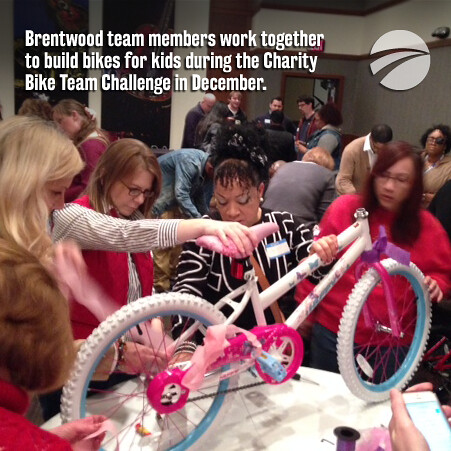 Corizon team members build and donate bikes for kids in holiday team building event