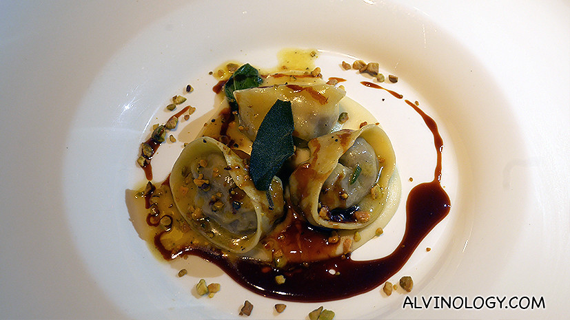 Hand-crafted Agnolotti filled with ox-tail, celeriac puree and toasted pistachio