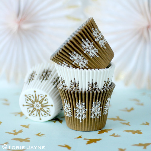 Gold and white decorative baking cases