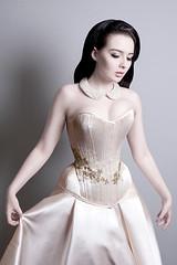 bride(0.0), bridal clothing(0.0), sleeve(0.0), human body(0.0), wedding dress(0.0), prom(0.0), neck(1.0), hairstyle(1.0), textile(1.0), gown(1.0), clothing(1.0), fashion(1.0), satin(1.0), formal wear(1.0), photo shoot(1.0), dress(1.0),