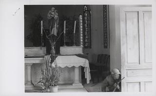 Marine Crouches Behind a Church Door, February 1968