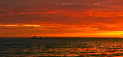 sunset ventura seacliff pier island pacific ocean coast surf westcoast california outdoor sky serene sea water shore landscape seaside cloud dusk beach orange red yellow