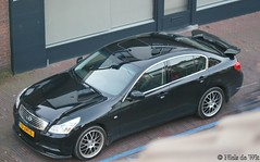 model car(0.0), nissan teana(0.0), sports car(0.0), automobile(1.0), automotive exterior(1.0), executive car(1.0), wheel(1.0), vehicle(1.0), automotive design(1.0), sports sedan(1.0), rim(1.0), mid-size car(1.0), infiniti g(1.0), bumper(1.0), sedan(1.0), infiniti(1.0), land vehicle(1.0), luxury vehicle(1.0),