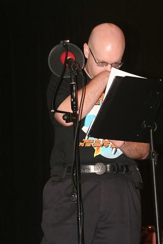 David Benedict examines his script.