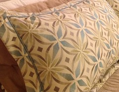 cushion(0.0), art(1.0), pattern(1.0), textile(1.0), furniture(1.0), brown(1.0), bed sheet(1.0), pillow(1.0), throw pillow(1.0),